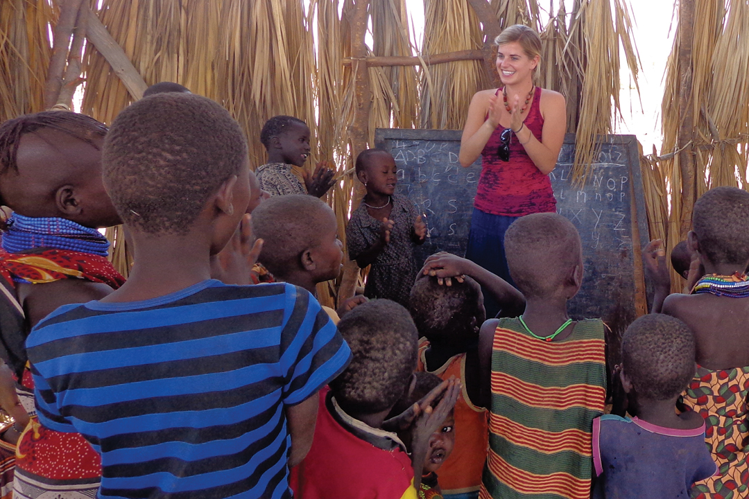 a student teaching a group of young students in another country