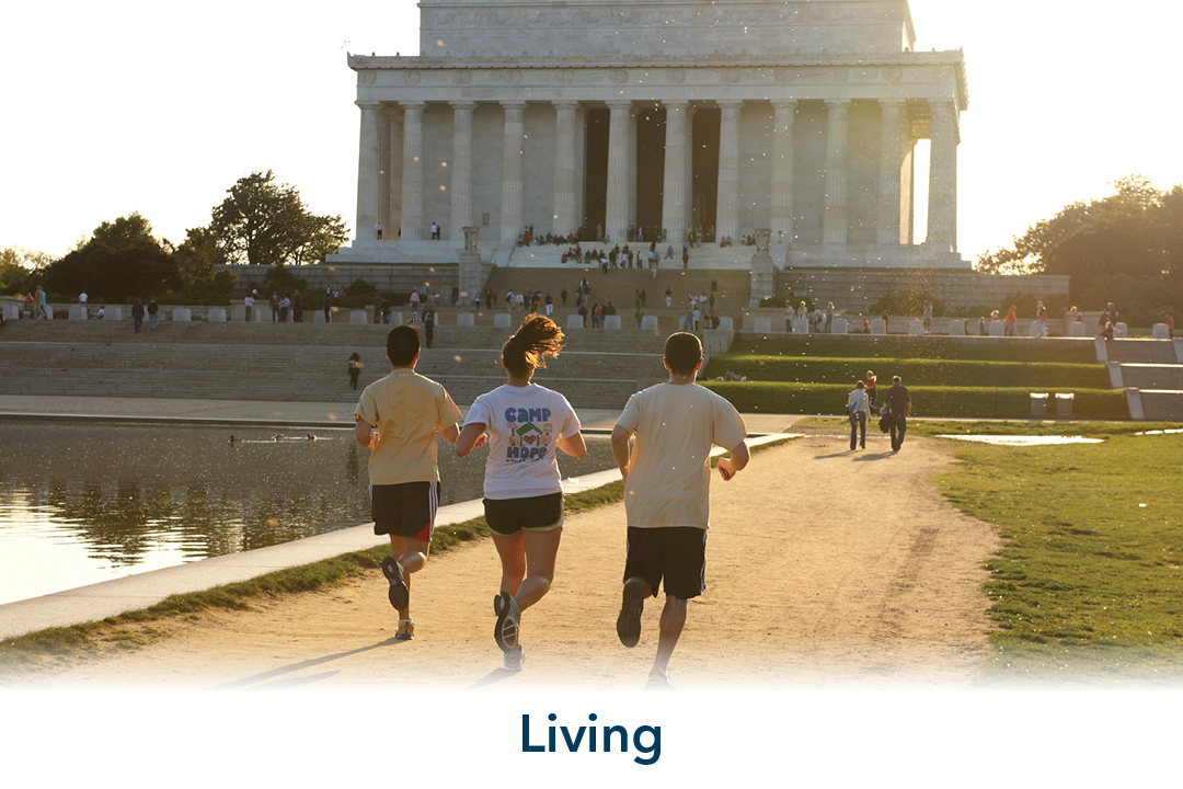 Living: three people jogging at the Reflecting Pool running towards Lincoln Memorial
